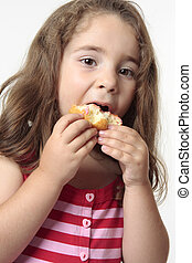 Child eating junk food donut. - Young child talking a big...