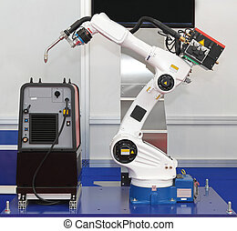 Robotic arm welder - White robotic arm for welding in...