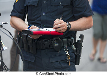 Police writes ticket - Policeman writes ticket in the city