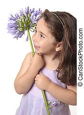 Pretty girl holding a beautiful flower