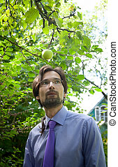 irradiation - thinking man under the apple in the garden