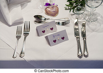 wedding place setting for bride and groom