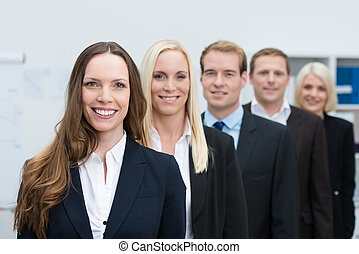 Group of successful young business people standing in a line...