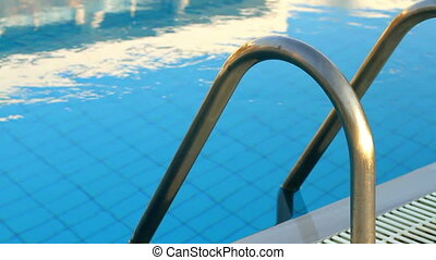 Swimming pool at different times of