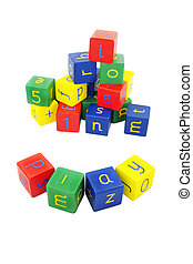 Coloured building blocks with letters on a white background...
