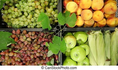 Market stall with fresh fruits and vegetables in boxes ready...