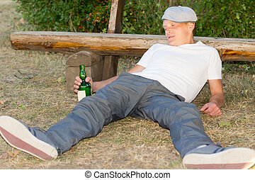 Addicted man experiencing lethargy after drinking - Addicted...
