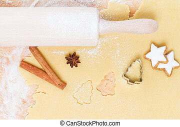 cutting out christmas shape cookies