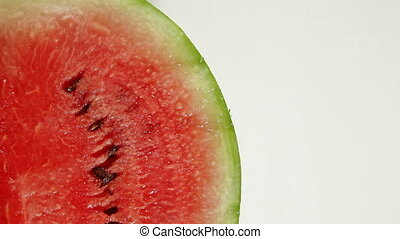 DOLLY: Sliced watermelon on white - Sliced watermelon on...