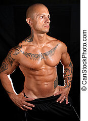 Body builder with tattoos - Body builder with big biceps...