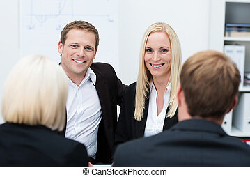Smiling coworkers in a business meeting