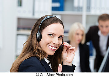 Happy call centre operator - Happy attractive young female...