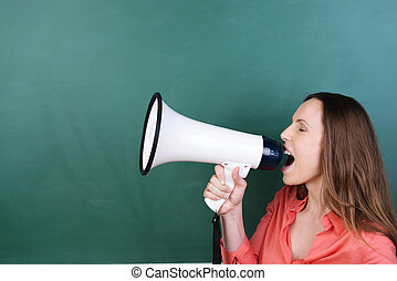Woman yelling into a megaphone - Side view of an attractive...