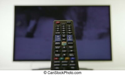 Television Remote Control - Remote control with a television...