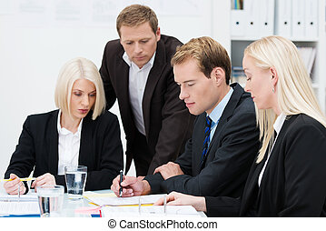 Business team brainstorming - Closeup view of a dedicated...