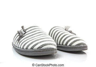 Pair of grey slippers on a white background