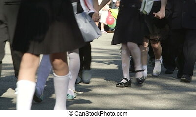 Back to School - Group of elementary students walking to...