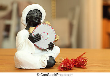 nubian sing and playing tambourine - A Nubian playing...