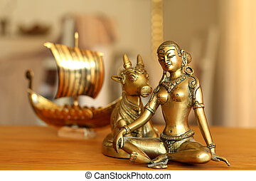 Parvati and a longboat - A longboat is approaching goddess...