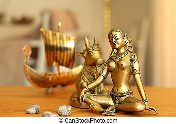 parvati and sea shells - A longboat is approaching goddess...