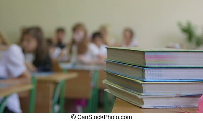 Lesson at school - Lesson in school textbooks in foreground,...