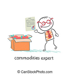 commodities expert stands next to a box of apples and keeps the document