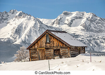 Winter Cabin and Idaho mountains - Snowy cold mountains with...