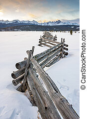 Antique wooden fence leads to winter mountains - Old fence...