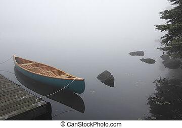 Canvas Cedar Canoe Tied to a Dock