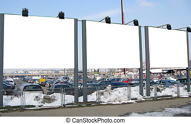 Three blank billboards - Three large blank billboards in the...