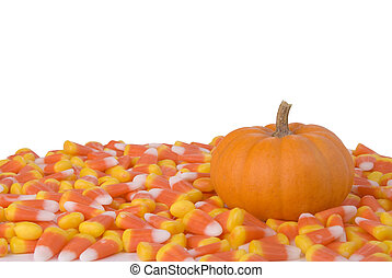 Pumpkin and Candy Corn - A little pumpkin surrounded by...