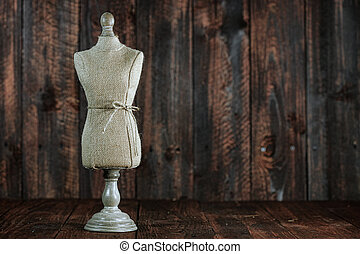Antique Mannequin Busts on Wood Grunge Background - Vintage...