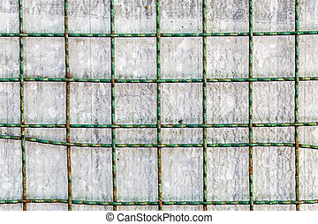 metal grid with metallic surface in background