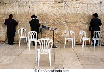 Jewish pray at the Western Wall in Jerusalem Israel -...
