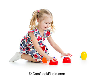 girl child playing with cup toys, isolated over white