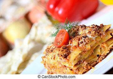 The Italian lasagna on a plate - The Italian lasagna on a...