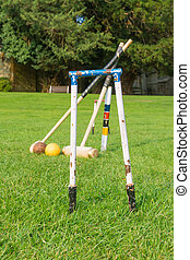 Croquet equipment propped up ready for use