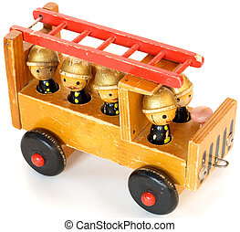 Old toy fire-engine - Ancient wooden toy fire-engine on a...