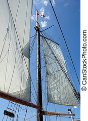 Sail - Big sail and Canadian flag on blue sky background