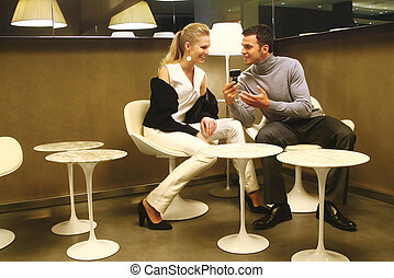 woman using mobile phone with boyfriend - Pretty young woman...