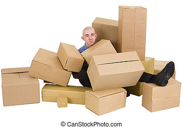 The man is heap up by boxes - The young man is heap up by...