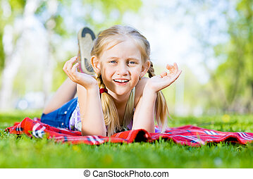 portrait of a smiling girl in a park