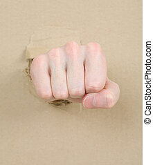 Fist - Gesture male hand through from hole in cardboard