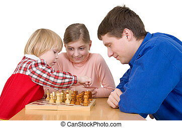 Man and child play chess on a white background