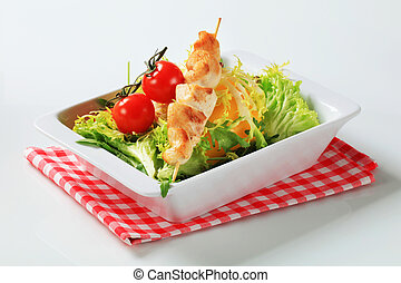 Chicken skewer with salad greens - Spring salad with chicken...
