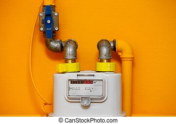 Gas meter on orange wall