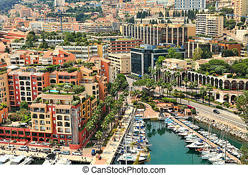 Yachts and modern buildings in Monte Carlo, Monaco - Small...