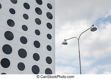 Building with round windows and streetlights - White...