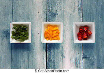 Colours - Photo of 3 bowls with paprika, parsley and red...