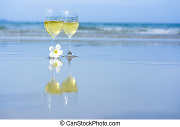 Two glasses of white wine - Reflection of two glasses of...